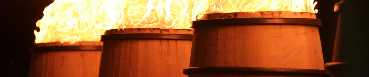 Barrels undergoing fire treatment
